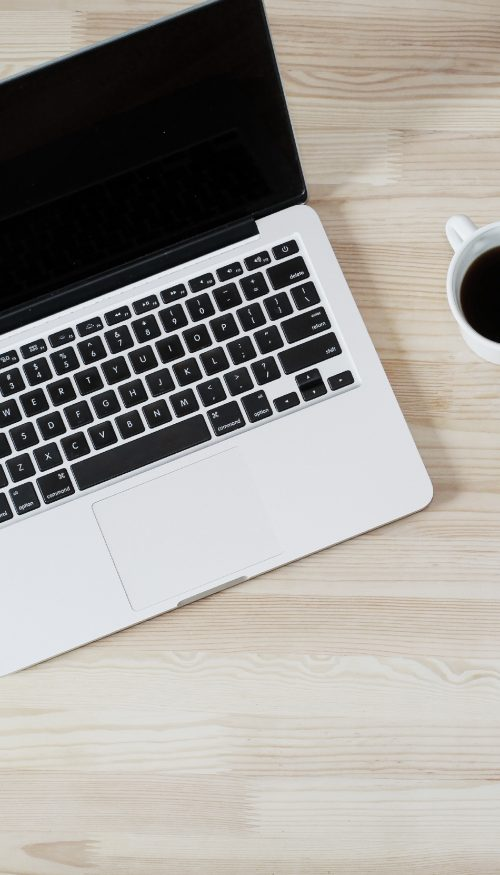 laptop and coffee to write about how blogging can help grow your business
