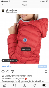 Screenshot of Instagram Shopping image of girl wearing ElevenElfs - Elfy vegan down jacket in Red.