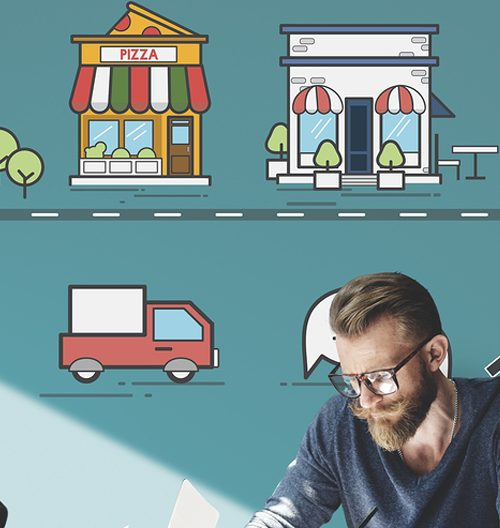 Bearded man sitting with paperwork, above his head are graphic icons of local stores.