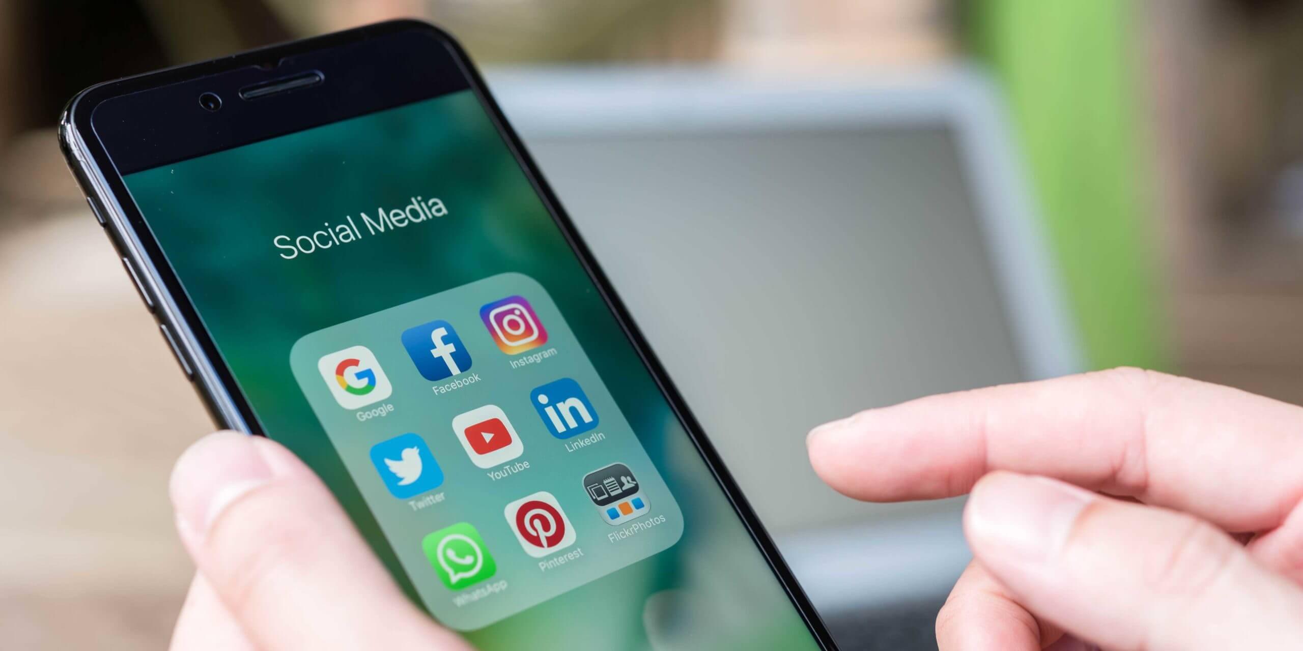 Hand posting on social media